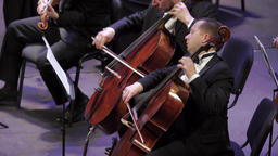 Cello musicians play the cello in the orchestra Footage
