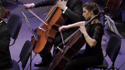 Girl cellist musician playing cello in orchestra Footage