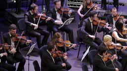 Orchestra on stage. Musicians play music Footage