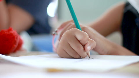 Close up shot hands of girl drawing with pencil shallow depth of field Footage