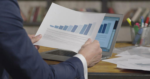 Slow Motion Portrait of Successful Businessman Flipping Through the Documents Footage