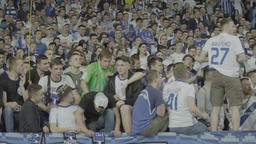 Football fans in the fan zone during the match. Slow motion Footage