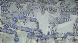 Football fans during the match keep scarves over their heads Footage