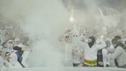 Tribune stadium in the smoke. Fan zone fans ultras Footage