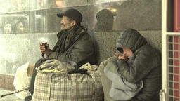 Beggars homeless people in the underpass Footage