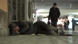 Poverty and Vagrancy. A homeless man sleeping on the floor Footage