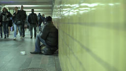 Poor begs for alms in the underground passage Footage