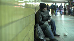 Homeless. Poverty. The beggar asks alms. Tramp Footage