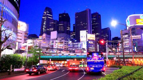 time-lapseshot of Shinjyuku skyscrapers and Yasukuni-street in Tokyo Footage