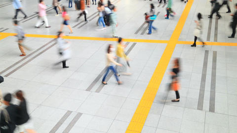 People walking through the busy train station in Tokyo Footage