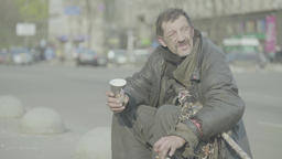 Poverty. A tramp in the street of the city Footage