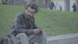 A homeless beggar looking into an empty wallet Footage