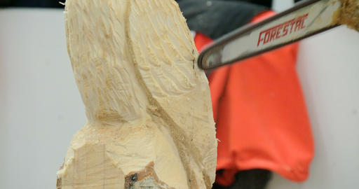 wood sculptor chainsaw close up 02 Footage