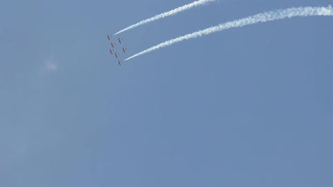 Formation from seven planes make loop at clear sky, white smoke from sides Footage