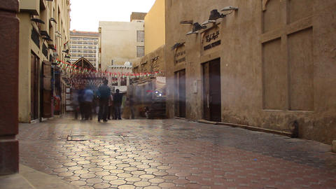 Smooth trace of people rush over old souk walkway, time lapse, evening Footage