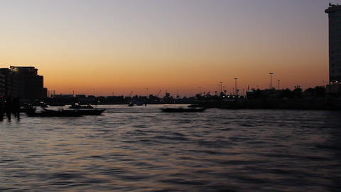 Dusk to night time lapse over Dubai Creek bend, dark shore, afterglow sky Footage