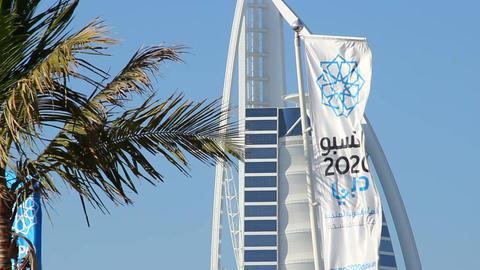 Dubai candidate city, World Expo 2020, logo and arabic inscription on white flag Footage