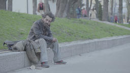 The homeless beggar sits on the street Footage