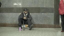 Beggar in the underground subway passage Footage
