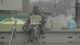 """Homeless beggar with a cardboard """"Work for food"""" and """"Need food"""" Footage"""