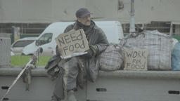 """Homeless beggar with posters """"Work for food"""" and """"Need food"""" Footage"""