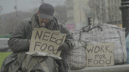 """Beggar with a cardboard """"Work for food"""" and """"Need food"""" Footage"""