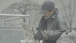 "Poster ""Need food"" in the hands of a beggar homeless man Live Action"