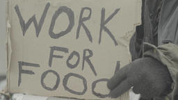 "Cardboard with the inscription ""Work for food"" Footage"