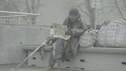 "Beggar with a cardboard with the inscription ""Need food"" Footage"