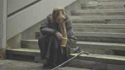 Poverty. Beggar homeless elderly woman Footage