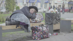 Poverty. Homeless woman sleeping on the street Footage