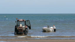 Runswick Bay man pushing boat Image
