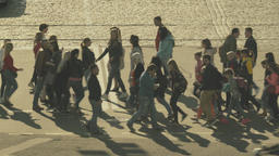 City life. A crowd of people crossing the road on a pedestrian crossing Footage