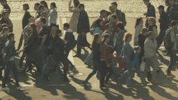 Population. A crowd of people cross the road on a pedestrian crossing Footage