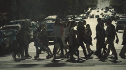 People cross the street on a pedestrian crossing. The crowd. Slow Motion Footage