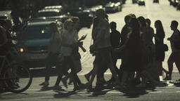 The crowd. People cross the street on a pedestrian crossing. Slow Motion Footage