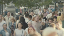 Crowded street. People in the crowd. Crowd. Slow motion Footage