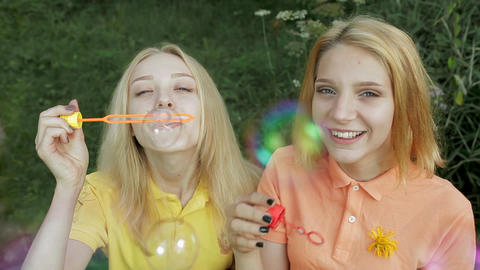 Girls blowing bubbles Image