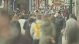 Many people walk down the street. Crowded street. Crowd. Slow motion Footage