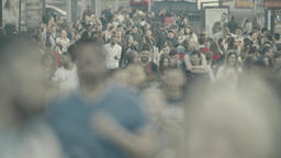 People are walking along a crowded street. Crowd Footage