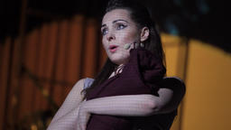 The play is on stage. Woman actress plays a role in the theater (opera) Footage