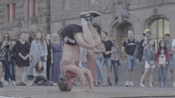Street dancer. The guy is dancing breakdance on the city street. Slow motion Footage