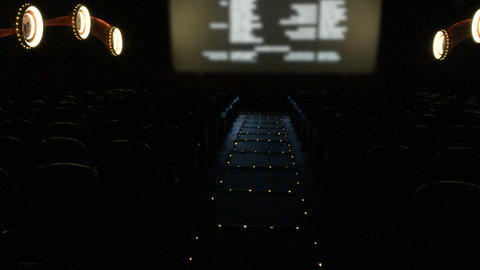 Empty movie theater with final credits rolling Archivo