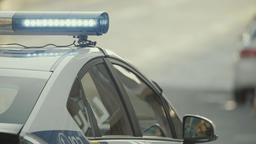 Police. Blinking police flasher on the roof of the police car. Close-up Footage