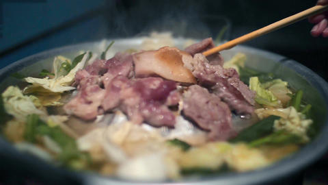 Pork Korean Barbecue on a hot pan with smoke Live Action