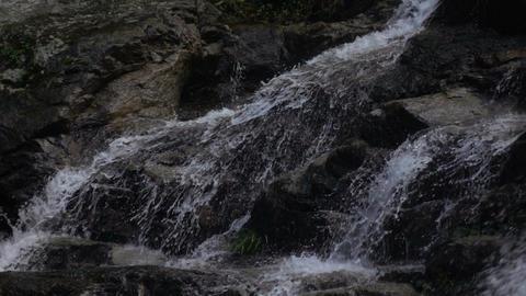 Waterfall falling on rock slow motion Footage