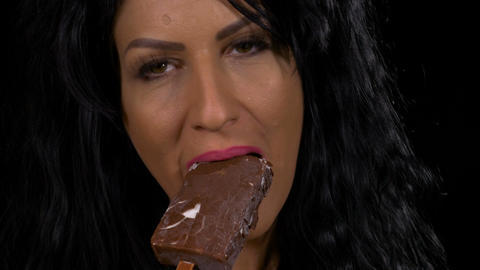 Sensual woman eating a delicious vanilla with chocolate topping ice cream Footage