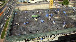 Workers prepare rebar and align communication structures before concrete pouring Footage