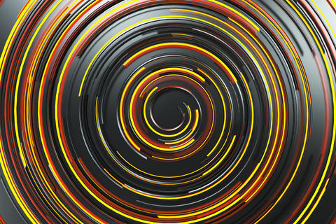 Black concentric spiral with orange glowing elements on black ba フォト