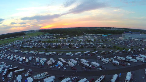 Aerial drone over trailers parked at stadium event Archivo